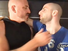 Two handsome men kissing and touching each other's cocks