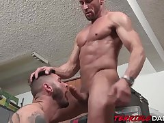 Daddy Myles Landon throat fucks inked bottom before bareback