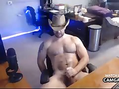 Muscle-bound cowboy wanking in live