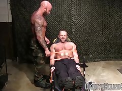 Muscly hunk restrained for rough and hardcore BDSM torment